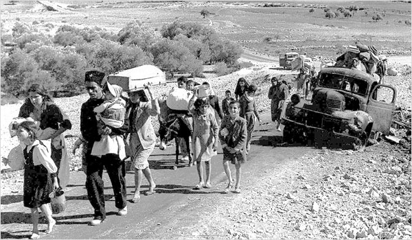 """Palestine refugees (British Mandate of Palestine - 1948). """"Making their way from Galilee in October-November 1948"""" Public Domain."""