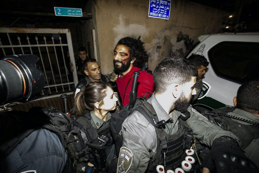 Israeli police officers take a Palestinian into custody during a demonstration at Sheikh Jarrah neighborhood after Israeli government's plan to force some Palestinian families out of their homes in East Jerusalem on May 04, 2021. Photo by Mostafa Alkharouf, Anadolu Images